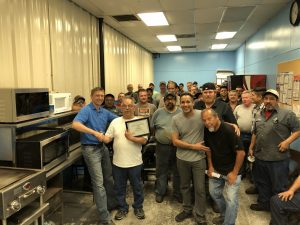 Employees celebrating Ricardo Santillan's 40th anniversary